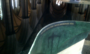 Reflections in the water surface of the stunning font in Salisbury Cathedral. photo taken in September 2012